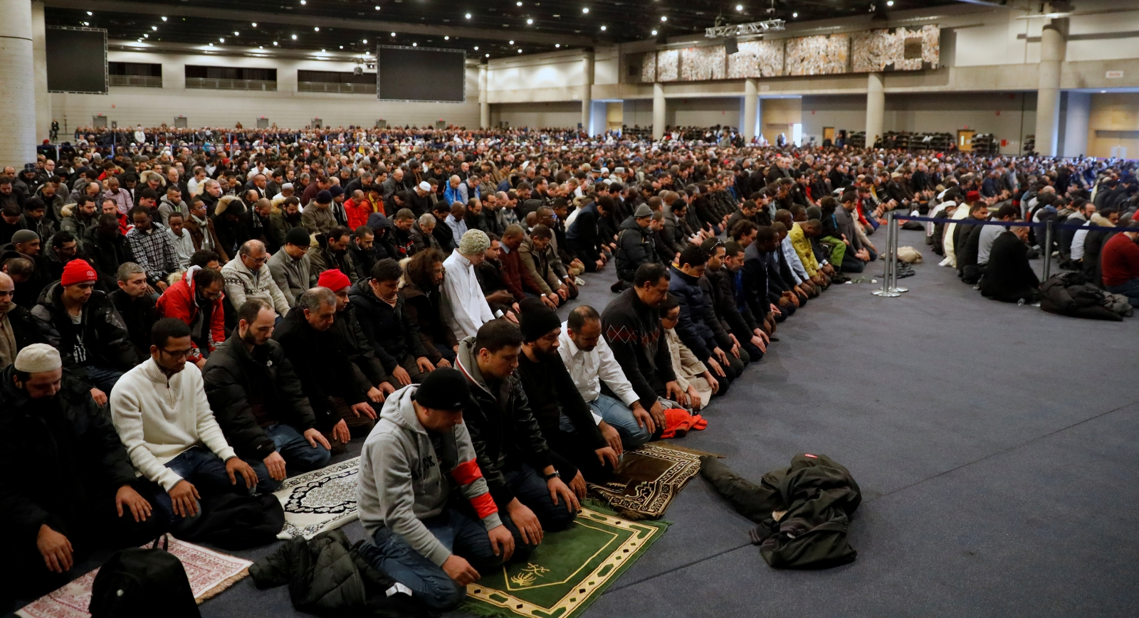 People pray during a funeral ceremony