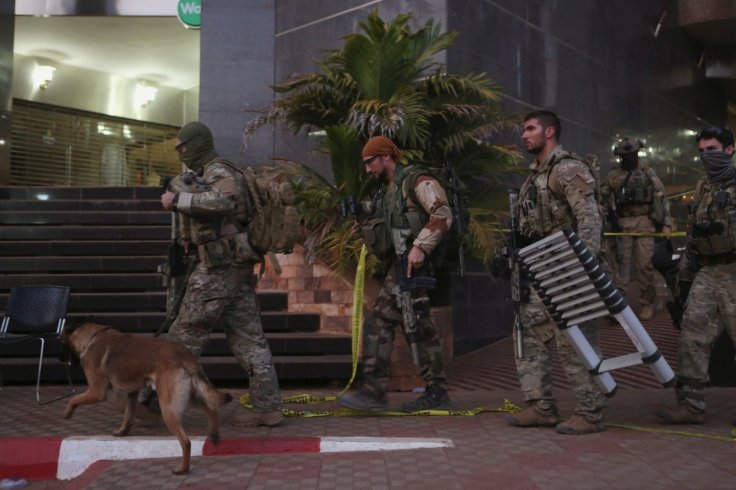 Soldiers leave the Radisson hotel in Bamako