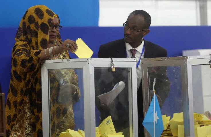 A Somali lawmaker casts her ballot