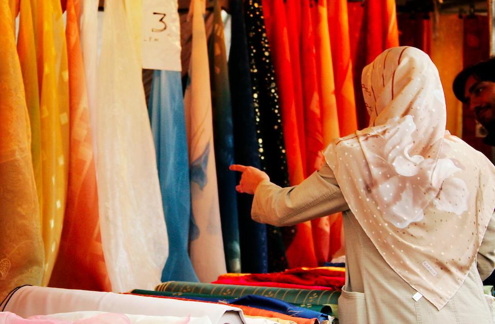 woman in german market wearing headscarf