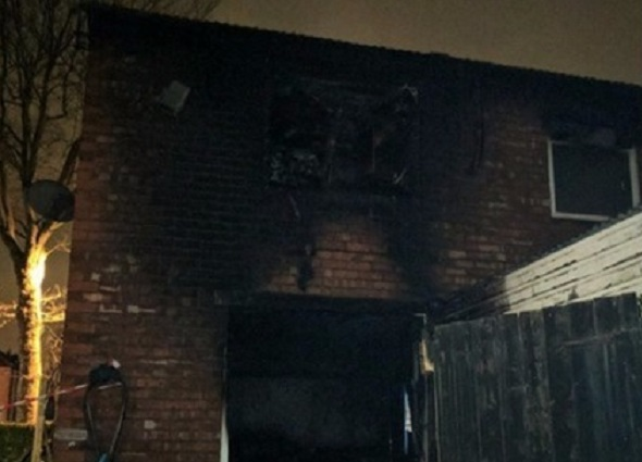 Manchester house fire sees four children and a man rushed to hospital