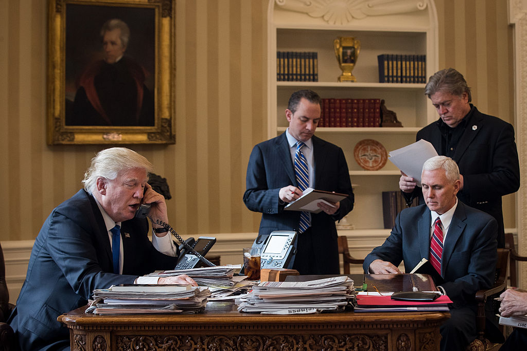 President Donald Trump speaks on the phone with Russian President Vladimir Putin in the Oval Office of the White House,