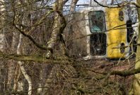 The wreckage of a passenger train is seen after it derailed in Kessel-Lo near Leuven, Belgium February 18, 2017