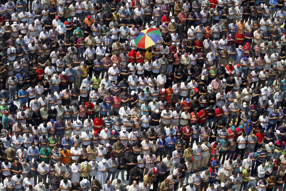 Protesters gather for Friday prayers in Tahrir square in Cairo