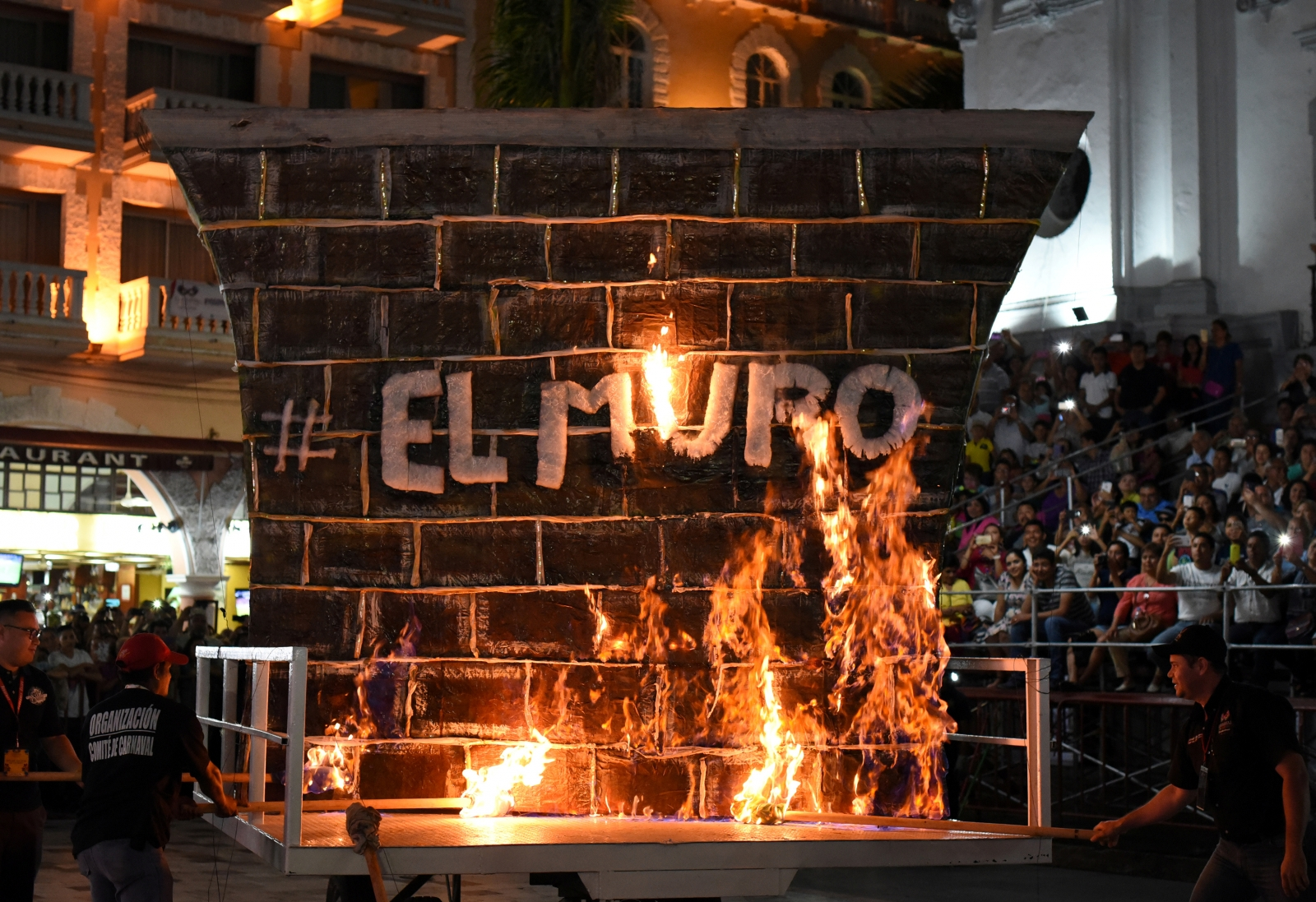 Mock US-Mexico border wall set ablaze