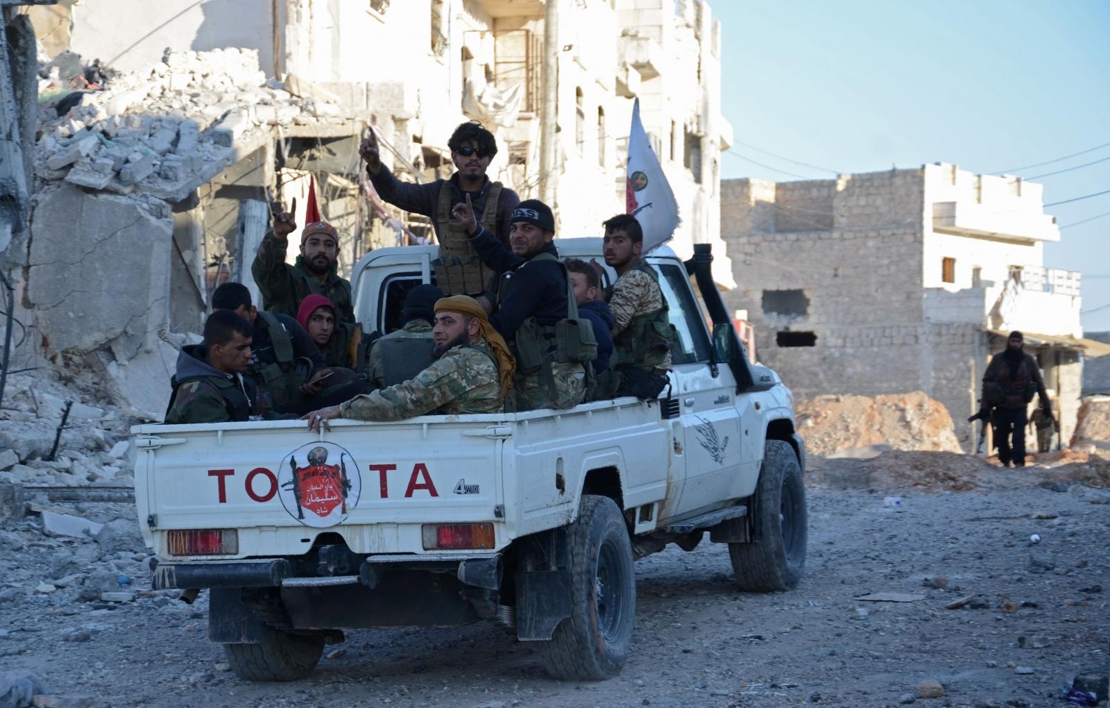 FSA fighters celebrate in al-Bab
