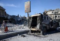 Burnt vehicle in al-Bab