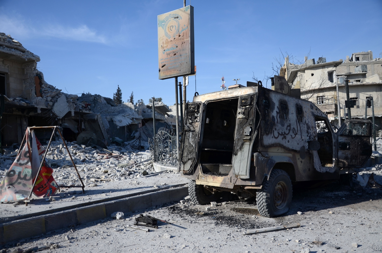 Burnt vehicle in al-Bab