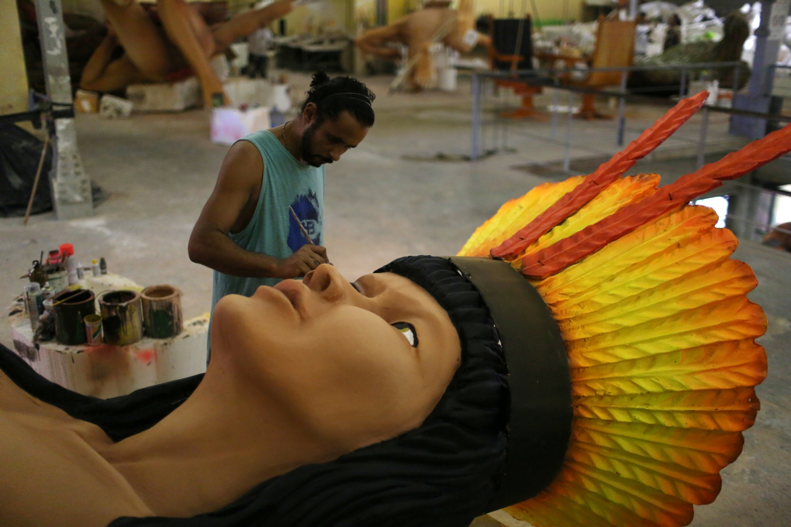 A worker from the Imperatriz Leopoldinense samba school prepares part of a carnival float