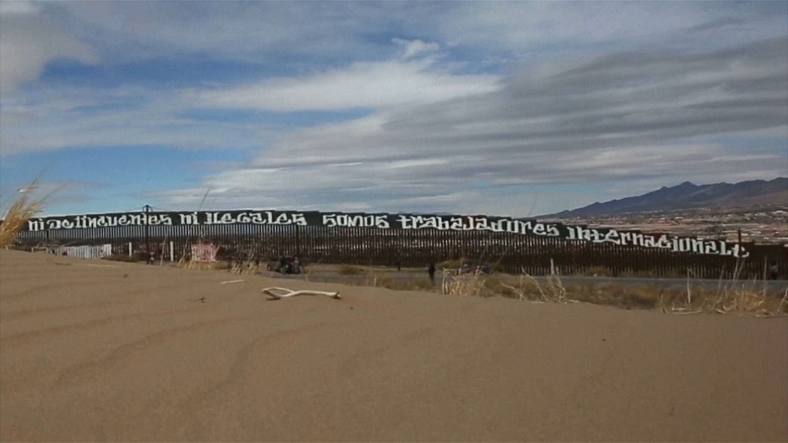 Mexican activists paint giant border wall message for Donald Trump