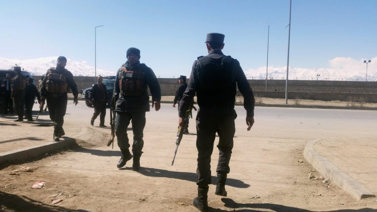 Afghan policemen arrive at the site of a blast