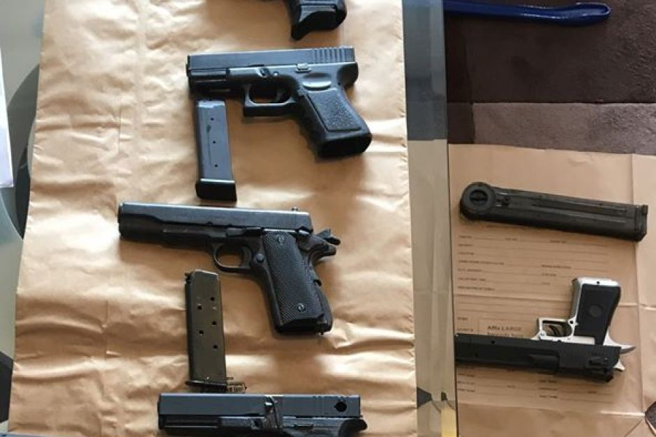 A cache of 3D printed pistols