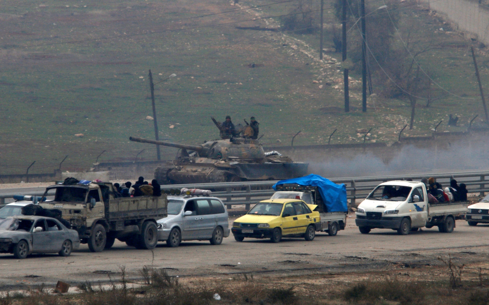 Vehicles bringing people out of eastern Aleppo