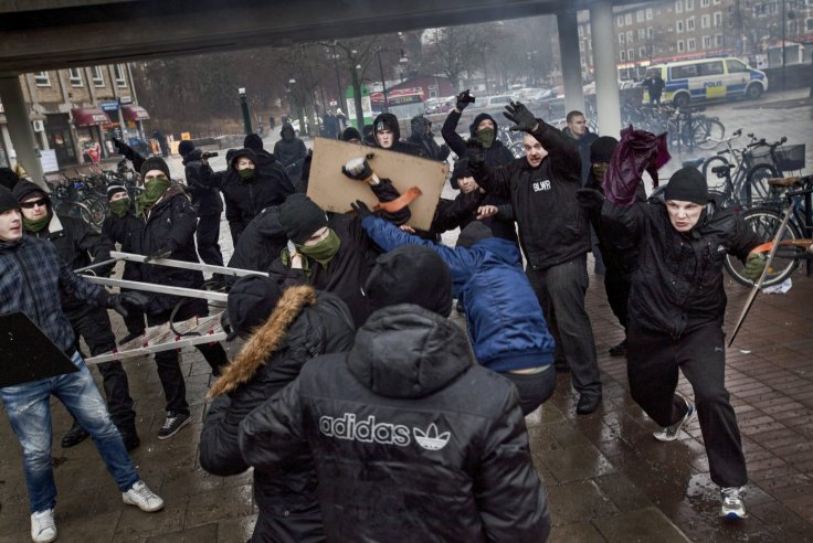 Right-wing extremists clash with members of an anti-Nazism demonstration in the Stockholm suburb of Karrtorp December 15, 2013.