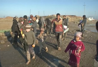 Civilians flee Mosul on muddy roads as battle rages on