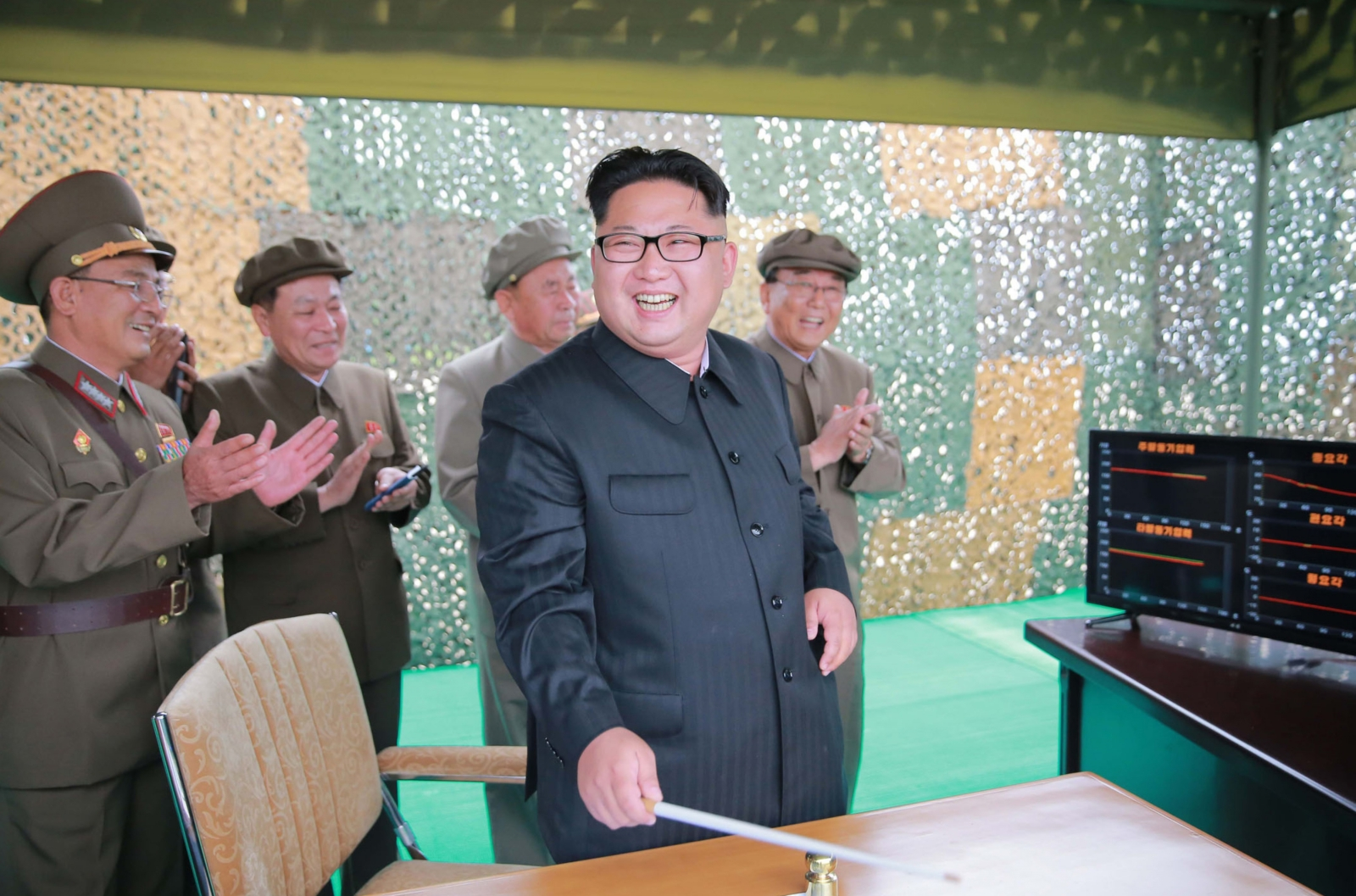 North Korean leader Kim Jong-Un (C) inspecting a test of the surface-to-surface medium long-range strategic ballistic missile