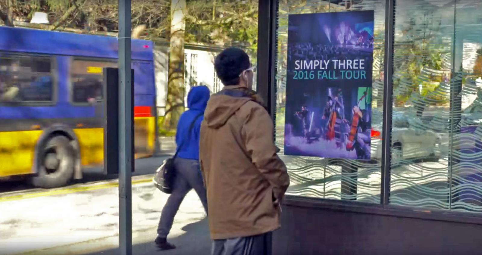 Man looks at singing poster