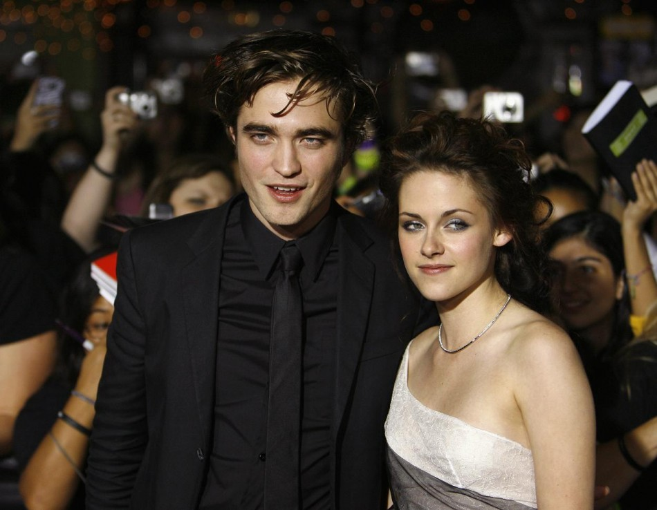 Robert Pattinson and Kristen Stewart pose at the premiere of the movie Twilight in Westwood.