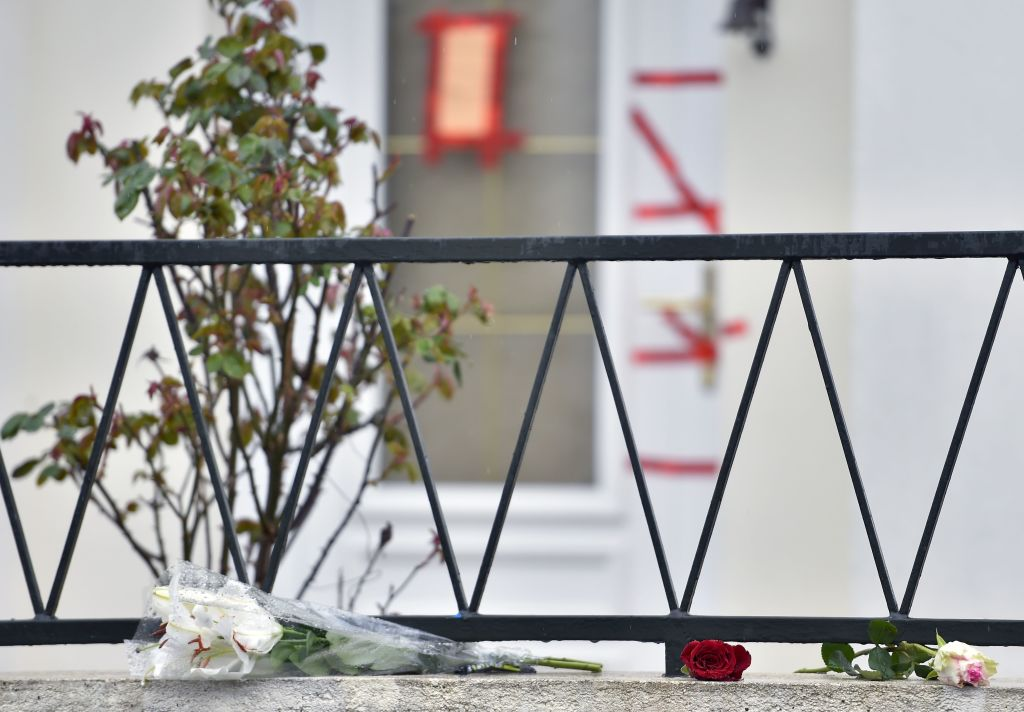 a bunch of flowers and roses laid in front of the entrance of the house of the Troadec family, the day after the brother in law of the father, Hubert Caouissin confessed the killing of all four members of the family.
