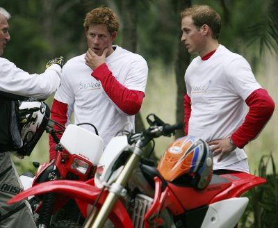 Britain039s Prince William and Prince Harry talk to co-organiser Mike Glover as they stand with their motorcycles before the start of the the Enduro Africa 08 charity motorcycle ride in Port Edward