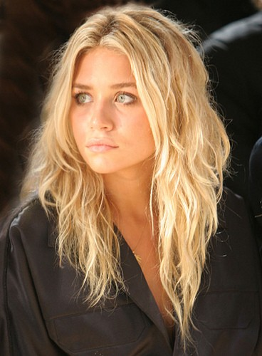 Mary Kate Olsen having fashion advices from twin Spotted clean-cut and classic at New York Fashion Week