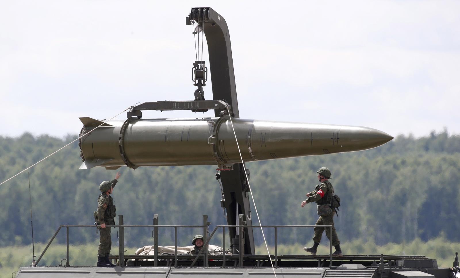 Russian servicemen equip an Iskander tactical missile
