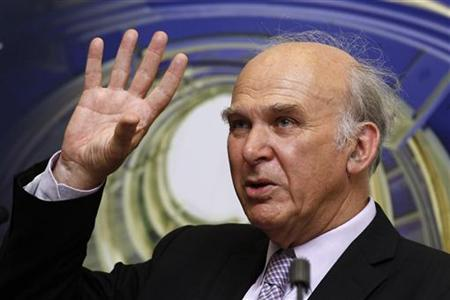 Business Secretary Vince Cable gestures during his speech at South Bank University in London