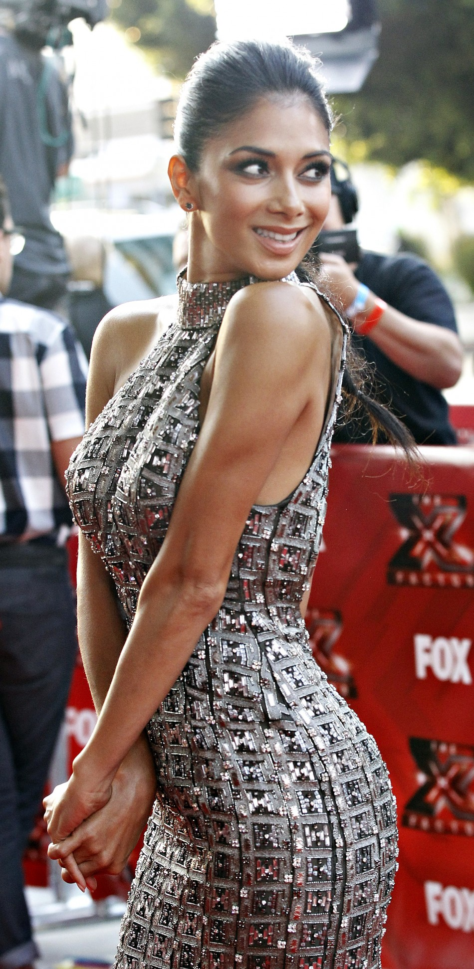 Judge Nicole Scherzinger poses at the world premiere of the television series quotThe X Factorquot at the Arclight Cinerama Dome in Hollywood, California