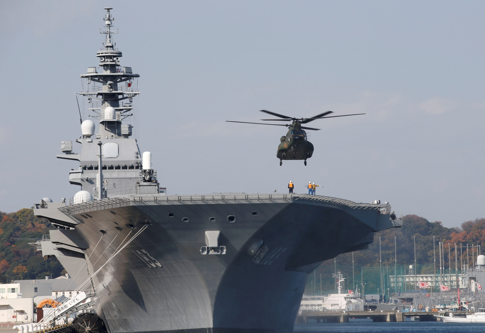 A helicopter lands on the Izumo, Japan Maritime Self Defense Force's (JMSDF) helicopter carrier