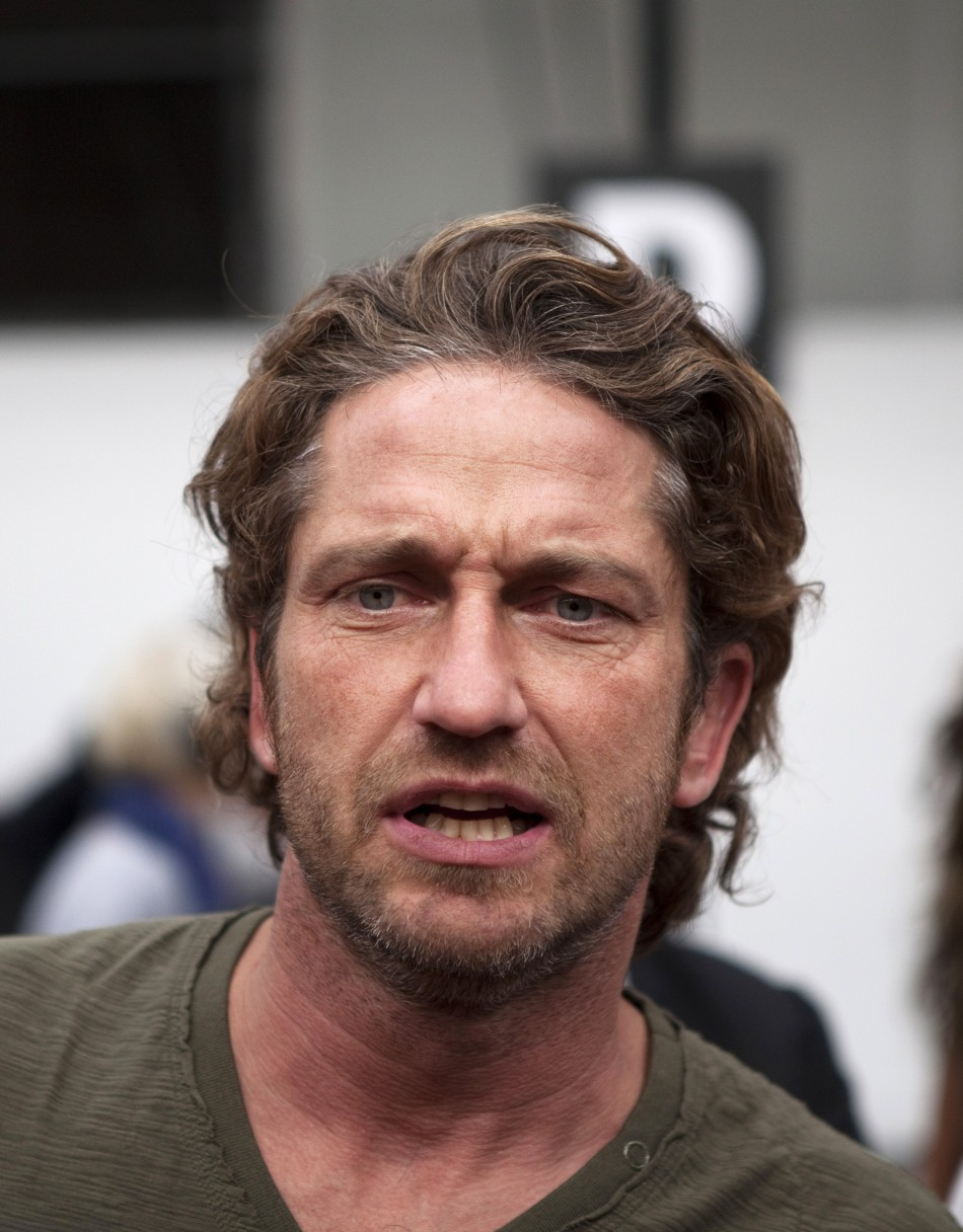 Gerard Butler speaks after watching the Diesel Black Gold Spring/Summer 2012 show during New York Fashion Week, September 13, 2011.