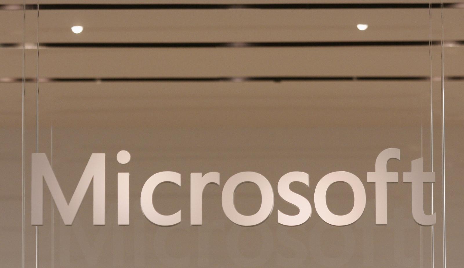 Microsoft and Adobe to share sales,marketing data