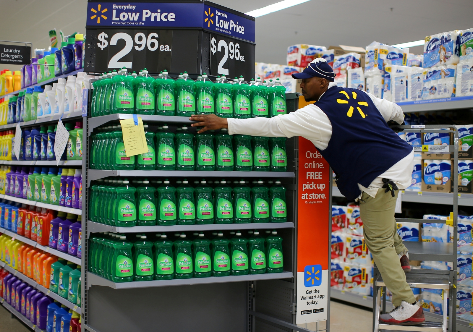 Shop assistant restocking shelves at Walmart