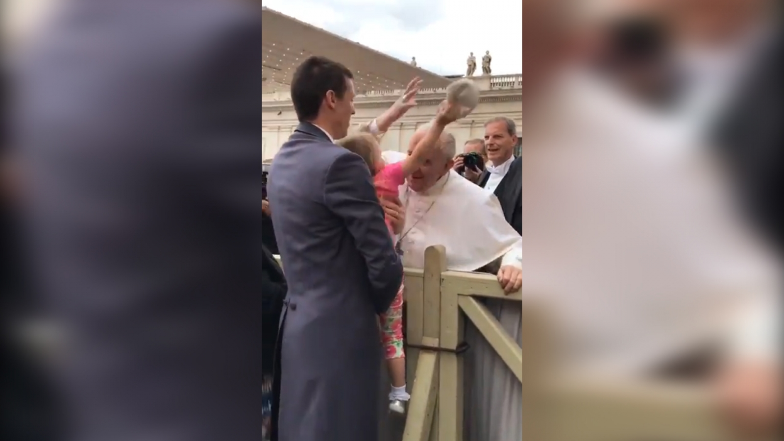 Little girl steals pope's hat
