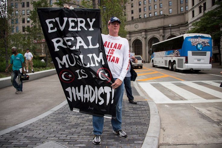 A Donald Trump supporter holds up an anti-Muslim poste
