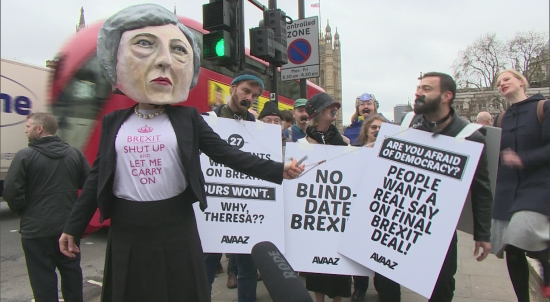 Theresa May effigy gags British citizens on Brexit