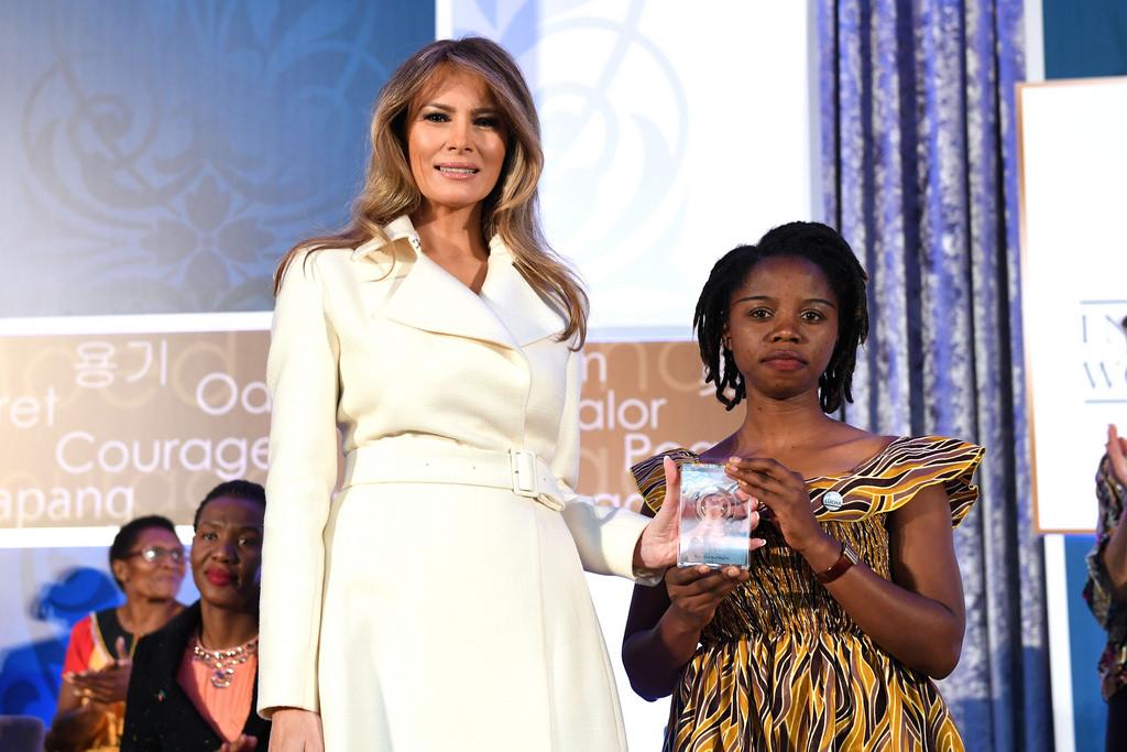 Melania Trump hands award to Rebecca Kabugho
