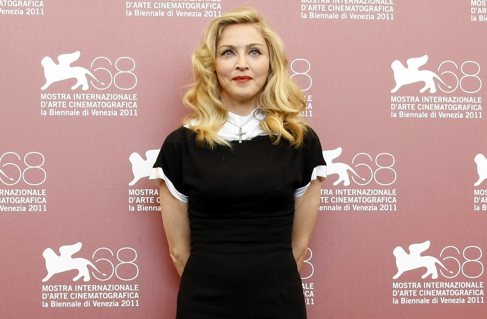 "U.S. pop star Madonna, director of the movie ""W.E"", poses during a photocall at the 68th Venice Film Festival"