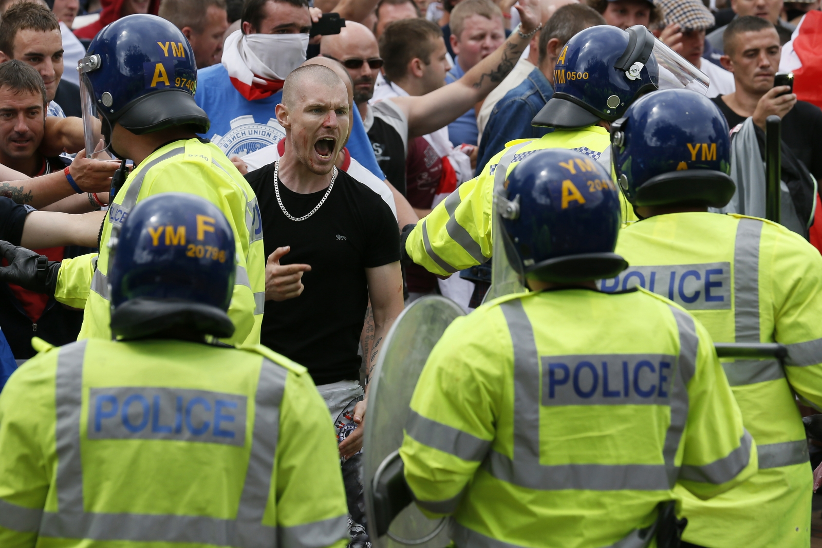 Members of the far-right EDL clash withpolice