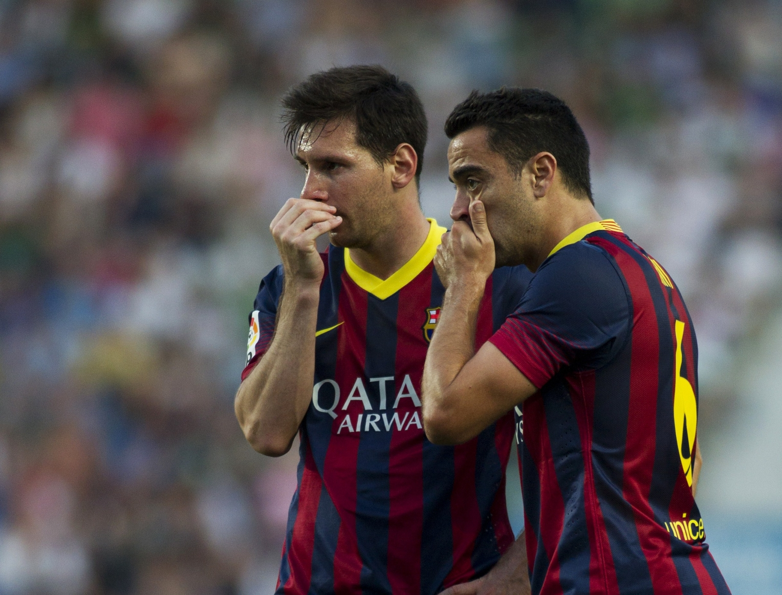 Xavi and Lionel Messi.