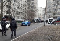 Russian police officers secure a residential area in St. Petersburg, Russia