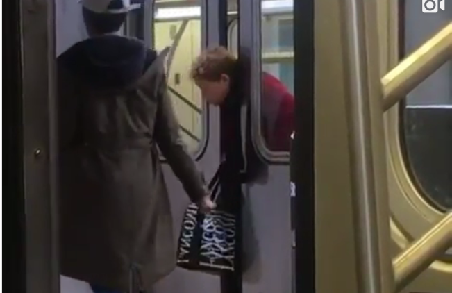 Woman with head stuck in subway