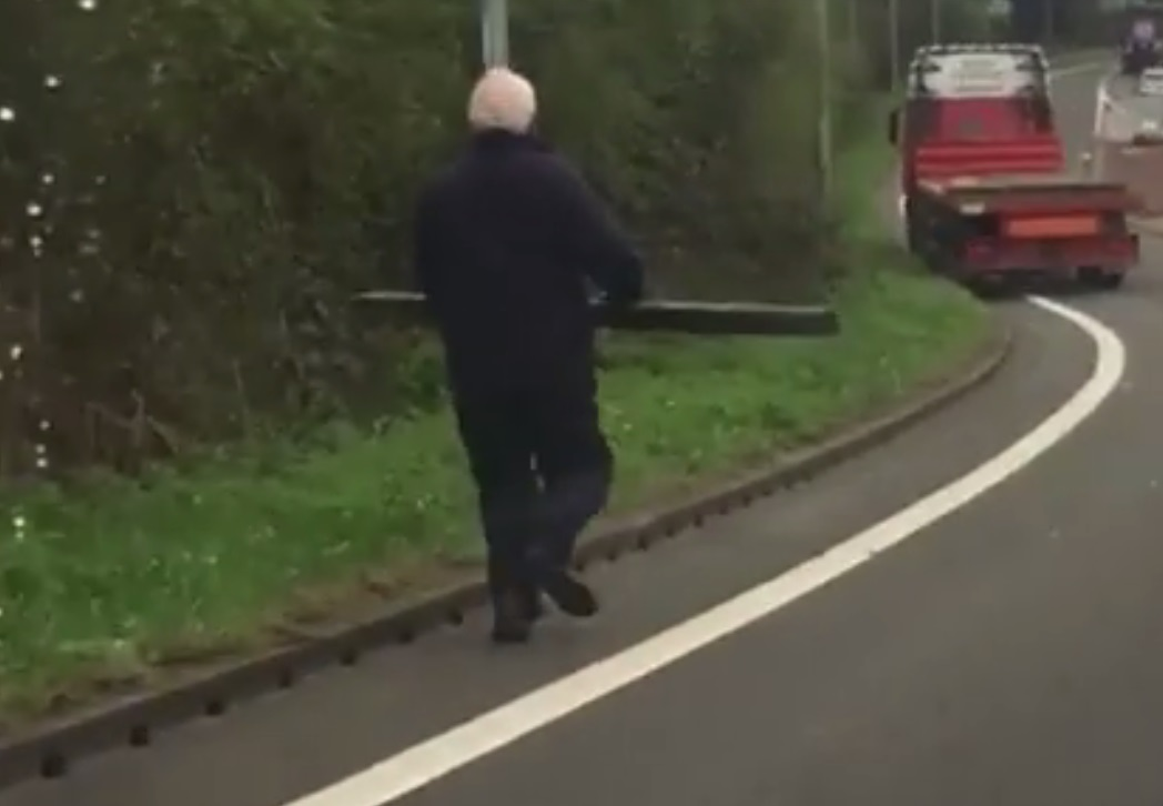 man chases lorry