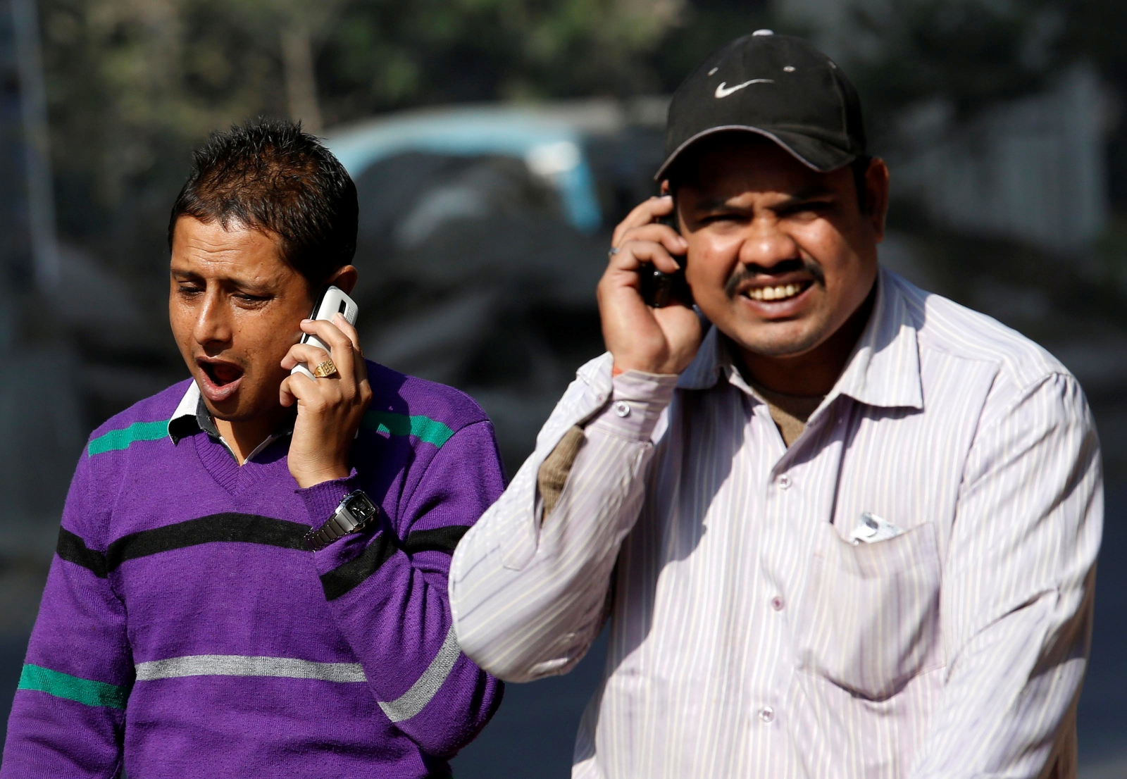 People on the phone in India