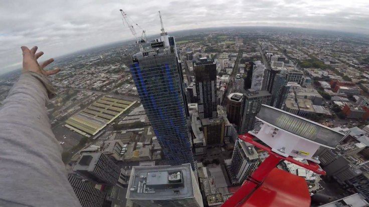 Death-defying daredevil records illegal 200m-high crane climb