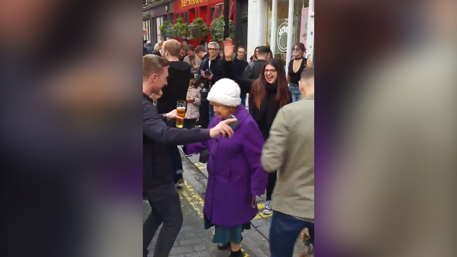 Elderly woman shows age doesn't matter as she shows off her dance moves in Soho