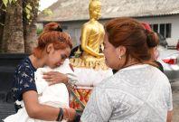 Chiranut Trairat cradles her baby