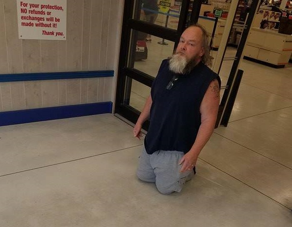 Disabled man forced to crawl out ofshop