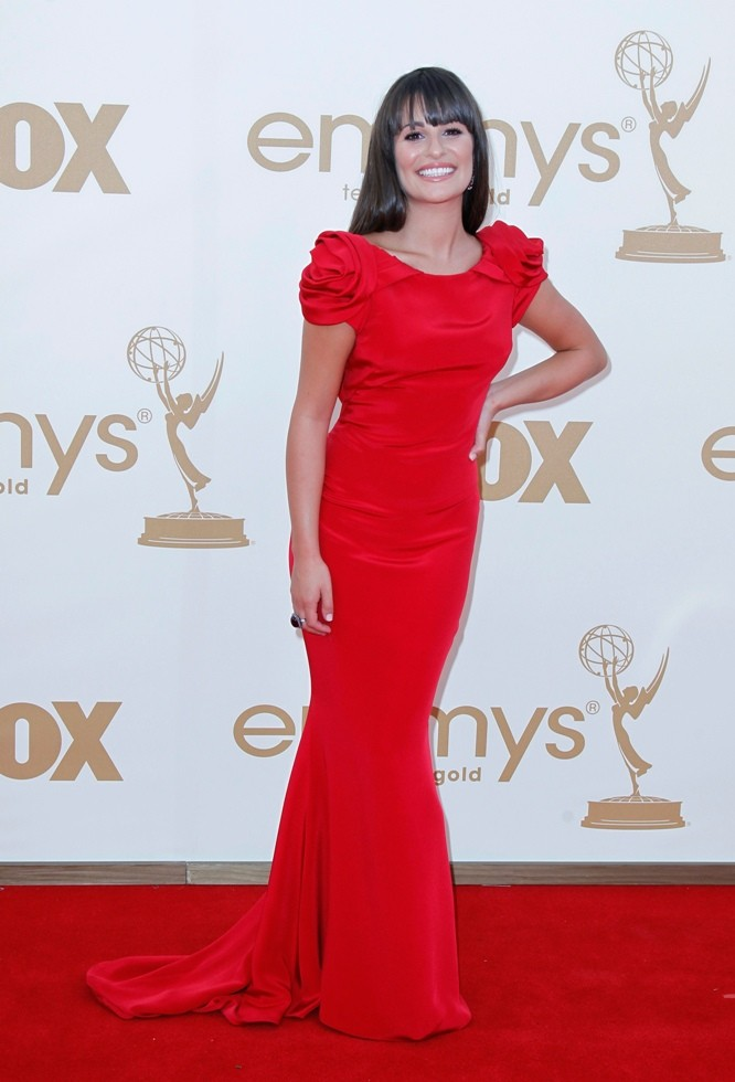 "Actress Lea Michele from ""Glee"" poses as she arrives at the 63rd Primetime Emmy Awards in Los Angeles"