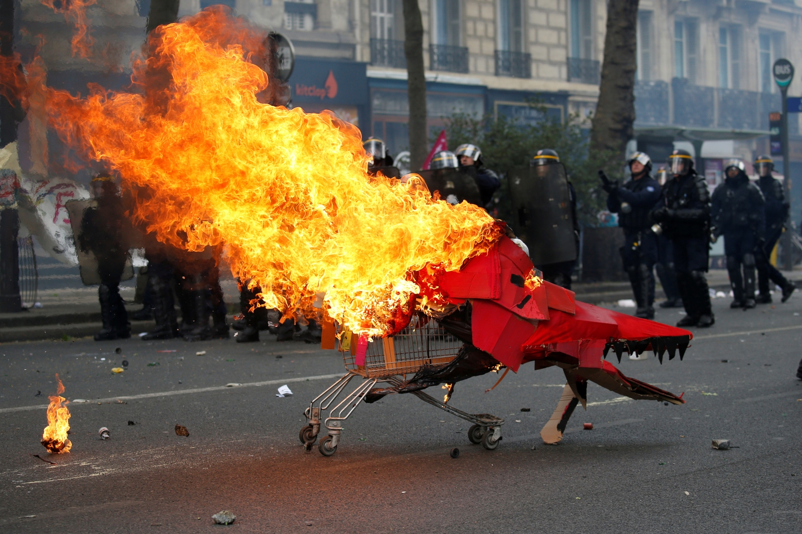 Protestors clash with riot police during May Day labour union march in Paris
