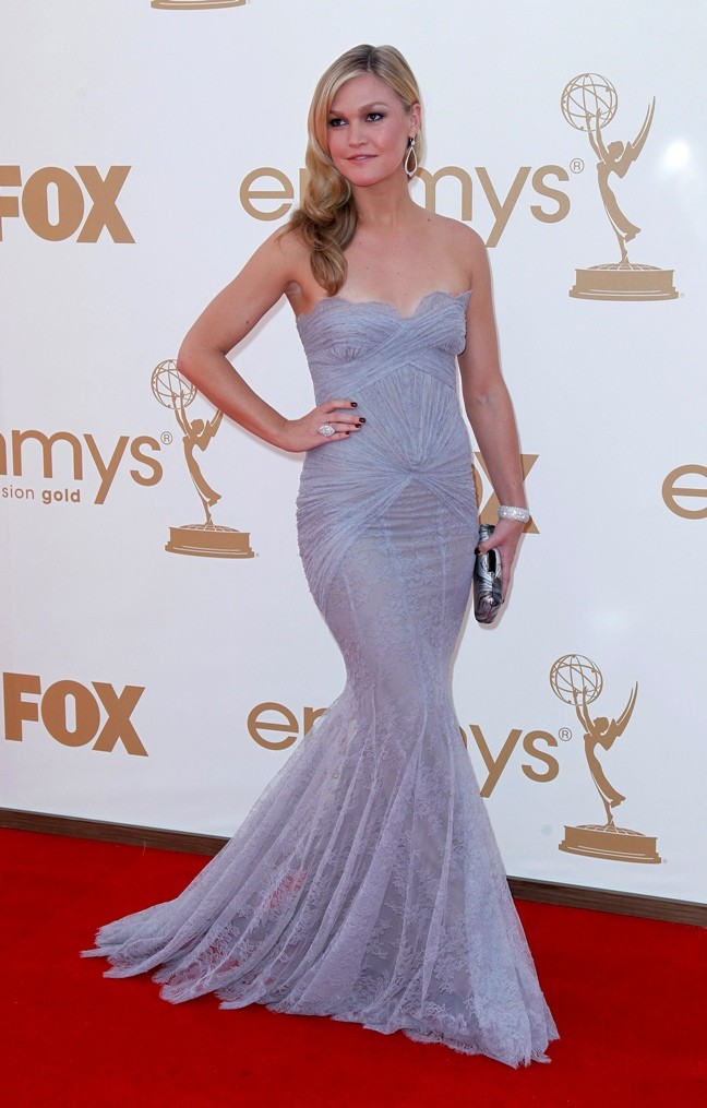 Actress Julia Stiles poses as she arrives at the 63rd Primetime Emmy Awards in Los Angeles